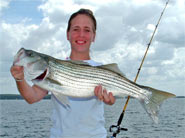 Tina has caught a big Striper.
